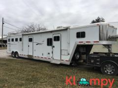 2001 Featherlite 4 horse trailer with 16 ft living quarters and 8 ft slide